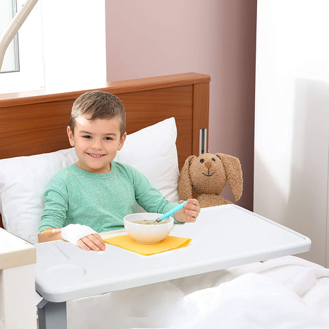 Child using the vaunn medical deluxe overbed table