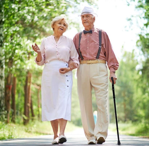 Adults walking with the Vaunn Medical cane