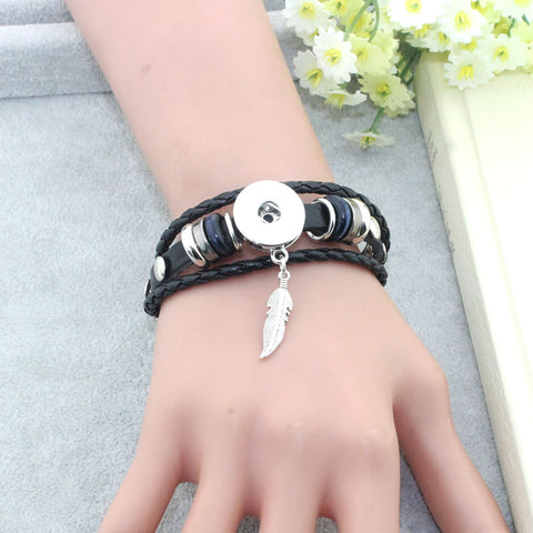 Braided Snap Bracelet With Feather Charm