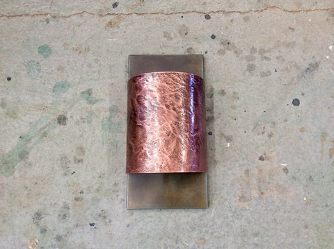 Copper light sconce with leather textured copper band + Steel backplate by Mike Dumas Copper Designs..