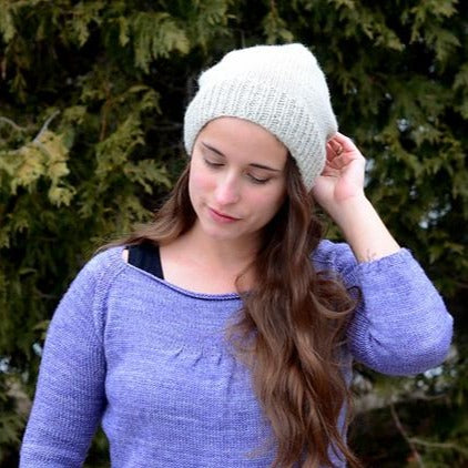 Woman wearing a slouchy handknit hat