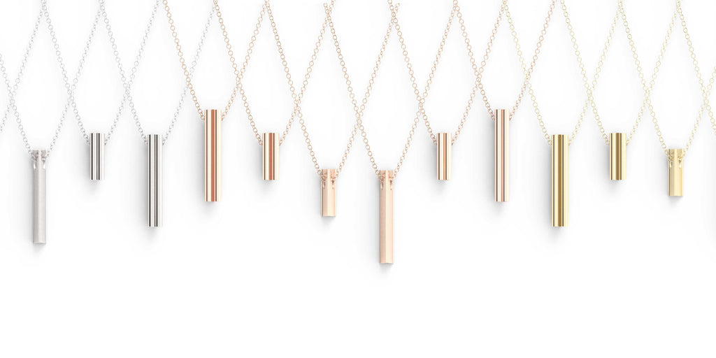 A selection of pendants in multiple colors of gold
