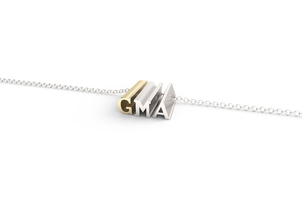 A 'GMA' pendant necklace for grandma in sterling and yellow gold.