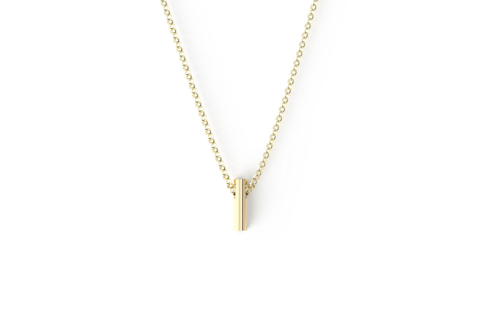 The shorty 14k yellow gold awareness ribbon. Pendant on a thick rolo 14k yellow gold chain.