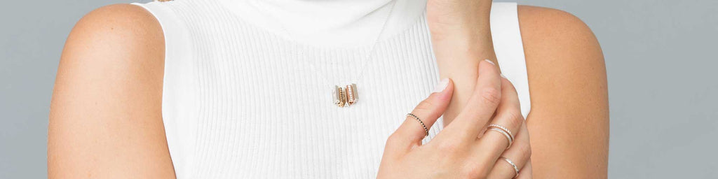 A white shirt as a blank canvas - Show off mixed metal shorty pendant necklace and ring stacks.