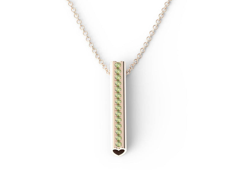 Peridot gemstones set down a rose gold Heart pendant on a rose gold chain