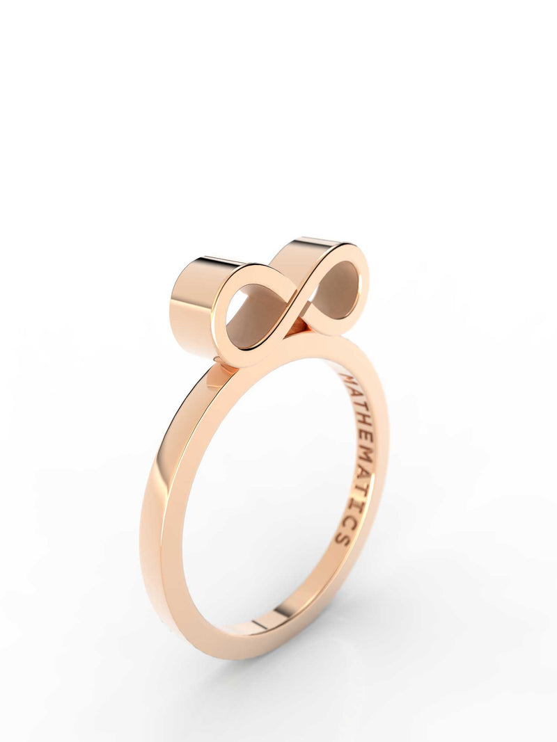 Top view of 14k yellow gold infinity slice ring, featuring length and look of slice ring design