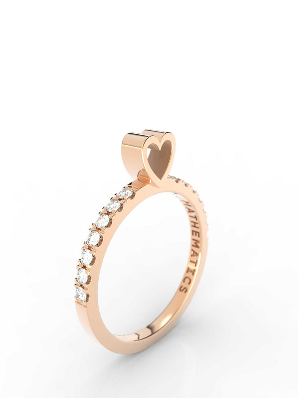 Top view of 14k yellow gold diamond pavé heart slice ring, featuring length and look of slice ring design, white diamonds