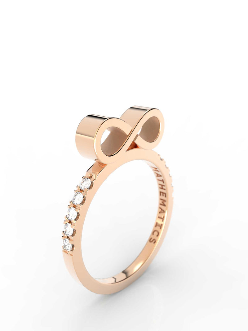 Top view of 14k yellow gold diamond pavé infinity slice ring, featuring length and look of slice ring design, white diamonds