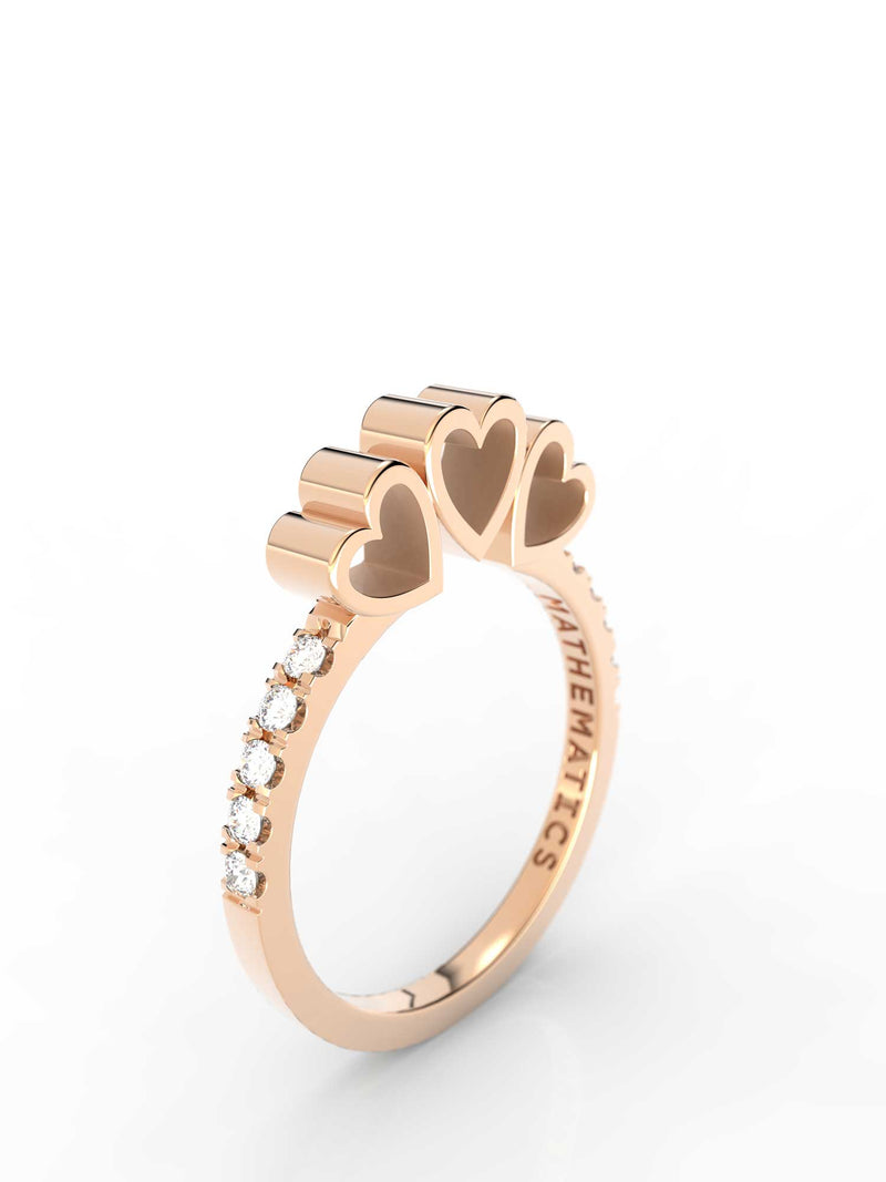 Top view of 14k yellow gold diamond pavé triple heart slice ring, featuring length and look of slice ring design and white diamonds