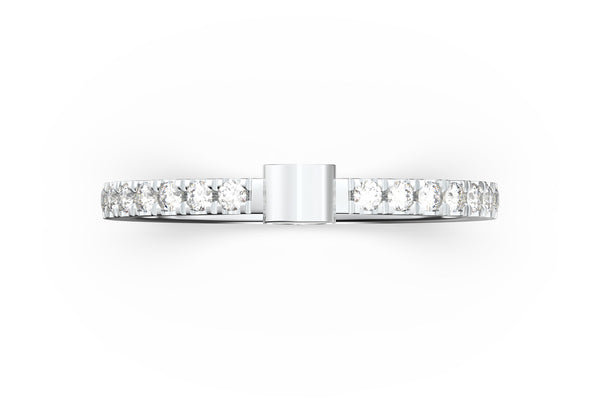 Top view of 14k white gold diamond pavé skull slice ring, featuring length and look of slice ring design, white diamonds