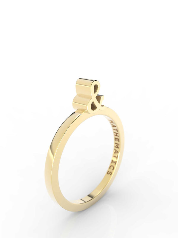 Isometric view of 14k yellow gold ampersand slice ring, featuring architectural slice design