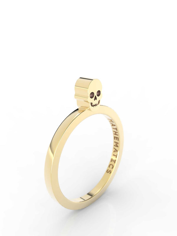 Isometric view of 14k yellow gold skull slice ring, featuring architectural slice design
