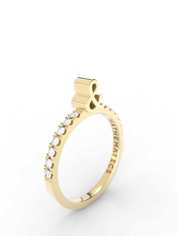 Isometric view of 14k yellow gold diamond pavé ampersand slice ring, featuring architectural slice design and white diamonds