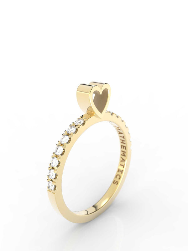 Isometric view of 14k yellow gold diamond pavé heart slice ring, featuring architectural slice design and white diamonds