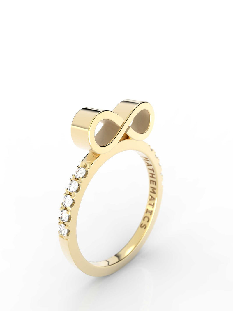 Isometric view of 14k yellow gold diamond pavé infinity slice ring, featuring architectural slice design and white diamonds