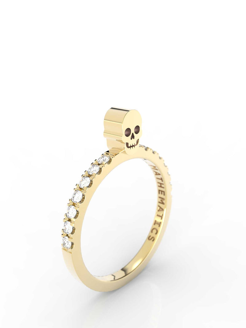 Isometric view of 14k yellow gold diamond pavé skull slice ring, featuring architectural slice design and white diamonds