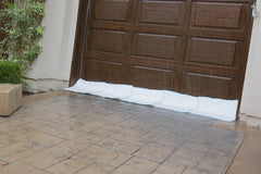 instant sandbags protecting floodwaters coming into garage home flood defense barrier