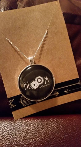 Bloom In the Dark logo necklace