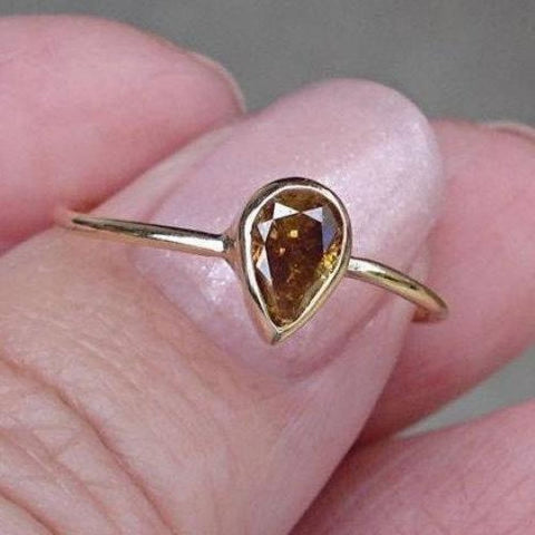 Image of Rings $499.00 0.45 Carat Golden Brown Pear Cut Diamond Bezel Set Ring In 14K Yellow Gold Bezel Brown Er Pear Yg