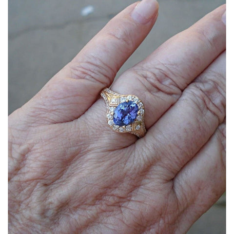 Rings $999.99 1.56 Carat Tanzanite And Diamond Ring - 14K Yellow Gold Blue Halo Oval