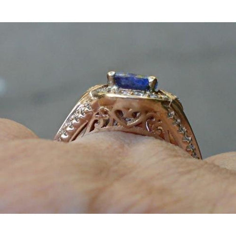 Image of Rings $999.99 1.56 Carat Tanzanite And Diamond Ring - 14K Yellow Gold Blue Halo Oval