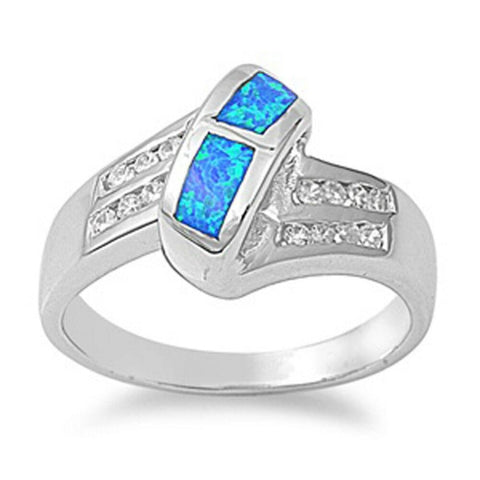 Image of Rings $53.32 Blue Simulated Opal in Mosaic Pattern with Clear Cubic Zirconia Stones Set in Criss-Cross Band blue clear cubic-zirconia cz