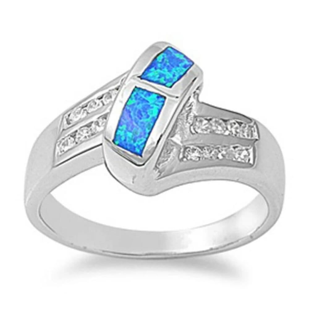 Rings $53.32 Blue Simulated Opal in Mosaic Pattern with Clear Cubic Zirconia Stones Set in Criss-Cross Band 50-100 badge-toprated blue clear