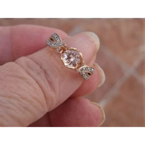 Rings $415 Petite Morganite and Diamond Twist in a Heart Shaped Prong Setting 14K Rose Gold Ring