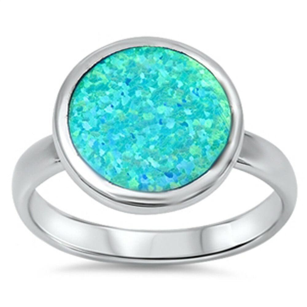 Rings $39.67 Round Sky Blue Opal Set in the Band blue opal round
