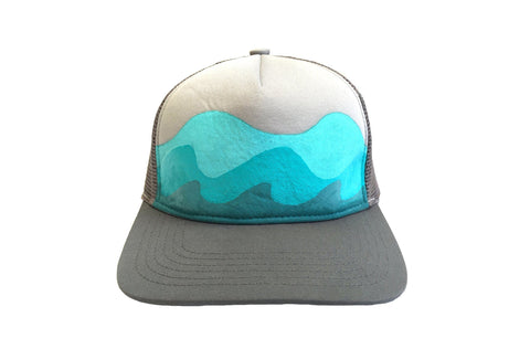 The Adventuress™ Trucker Hat