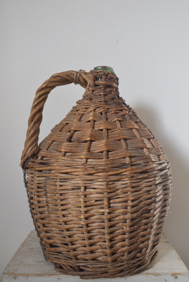 Vintage wine Demijohn in original cane basket