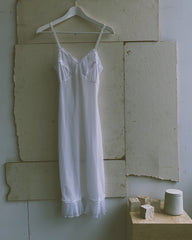 vintage nylon slip with pleat detail.