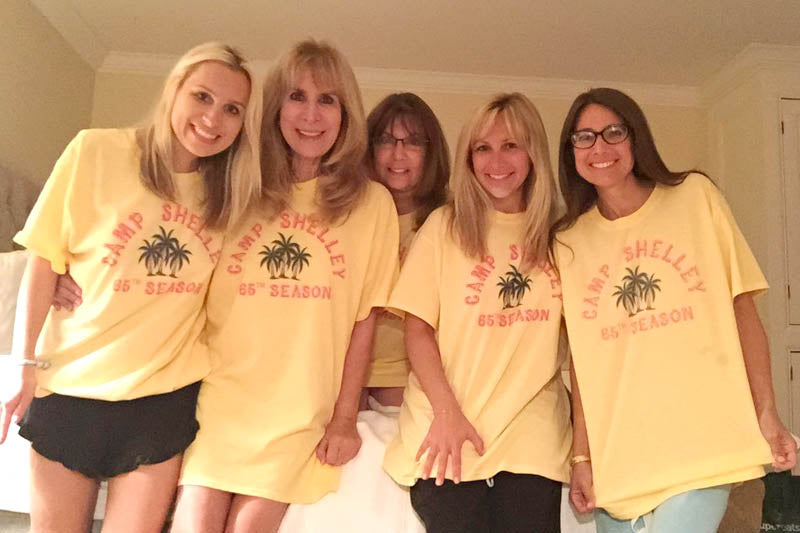 """Girls and women with custom t-shirts """"camp shellley 65th season"""""""