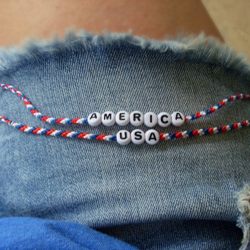 red white and blue word bracelets