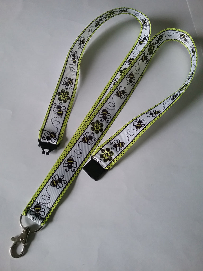 Honey bee with yellow border patterned ribbon lanyard made with a safety breakaway id or whistle holder with swivel lobster clasp - Tilly Bees