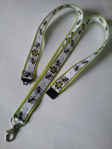 Honey bee with yellow border patterned ribbon lanyard made with a safety breakaway id or whistle holder with swivel lobster clasp