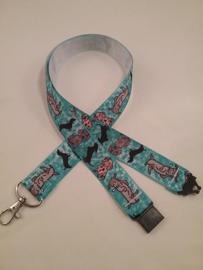 Turquoise blue cartoon dachshund patterned ribbon lanyard made with a safety breakaway id or whistle holder with swivel lobster clasp - Tilly Bees