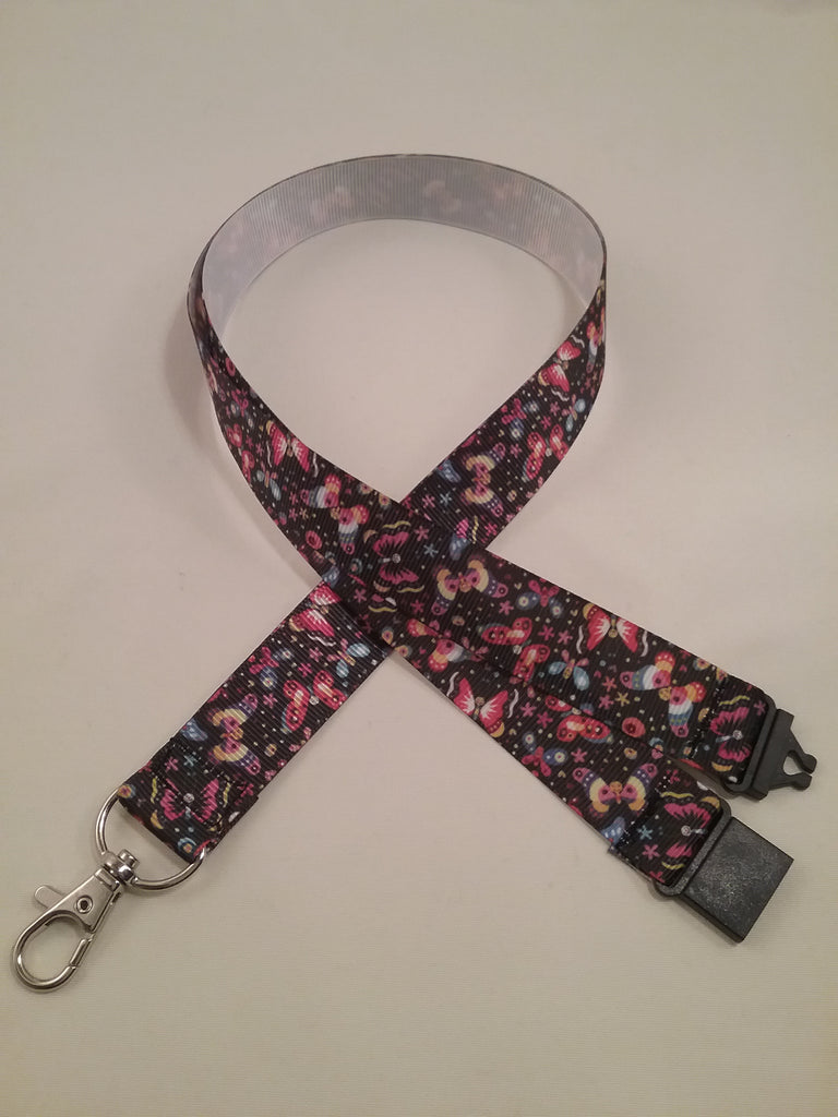 Coloured butterfly patterned ribbon lanyard made with a safety quick release breakaway id or whistle holder with swivel lobster clasp - Tilly Bees