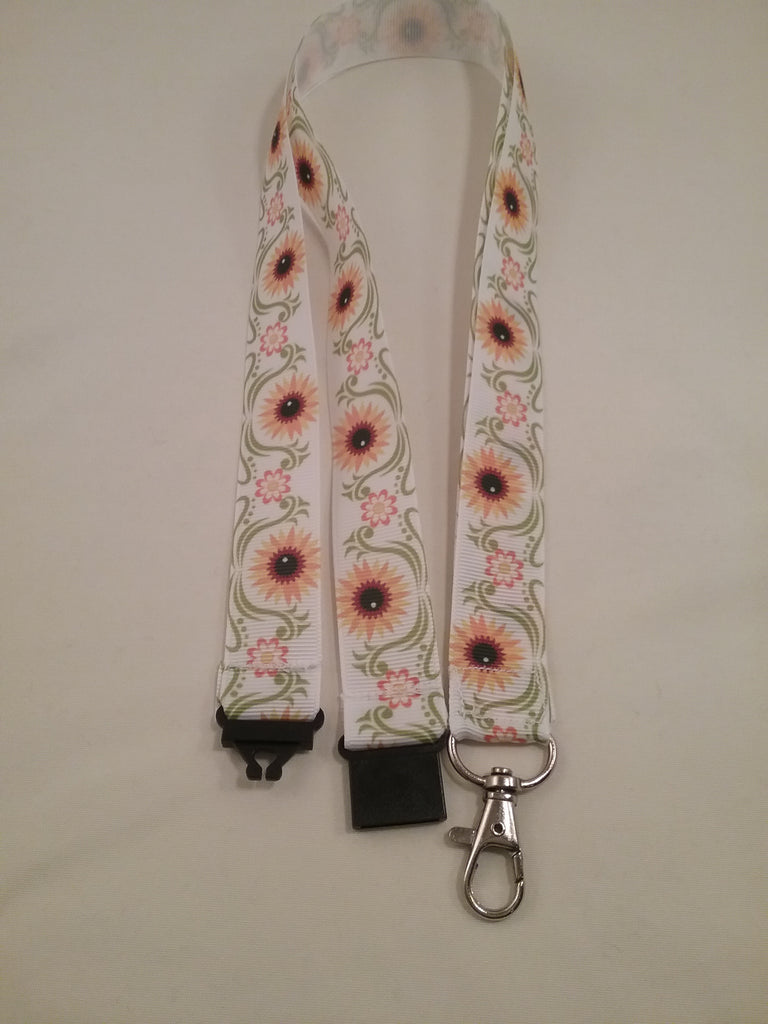 Sunflowers yellow on white ribbon lanyard made with a safety quick release breakaway id or whistle holder with swivel lobster clasp - Tilly Bees