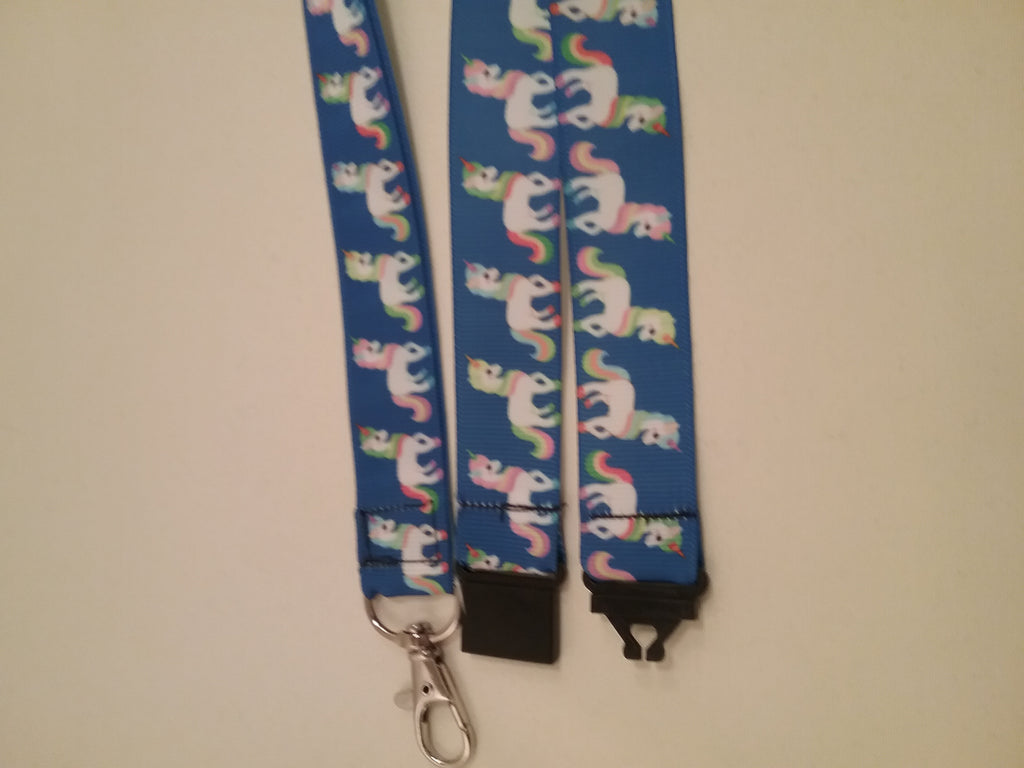 Unicorn on dark blue ribbon lanyard made with a safety quick release breakaway id or whistle holder with swivel lobster clasp - Tilly Bees