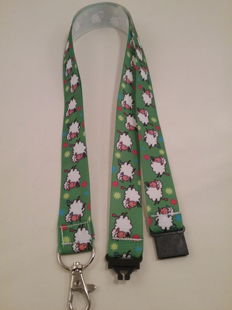 Jumping sheep on green ribbon lanyard made with a safety quick release breakaway id or whistle holder with swivel lobster clasp - Tilly Bees