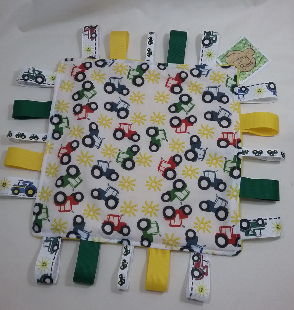 Handmade Childs taggie comfort snuggle blanket tractor themed fabric and yellow fleece plus lots of coloured grosgrain inc tractor ribbons - Tilly Bees