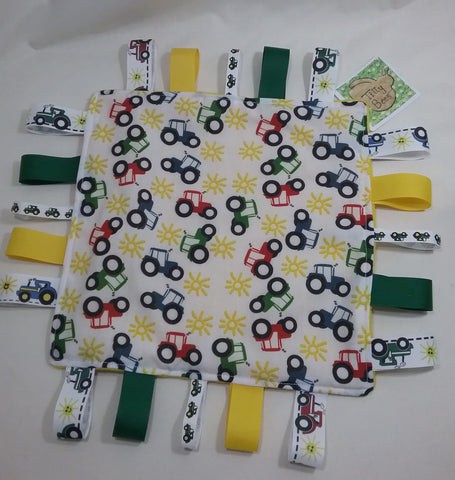 Handmade Childs taggie comfort snuggle blanket tractor themed fabric and yellow fleece plus lots of coloured grosgrain inc tractor ribbons