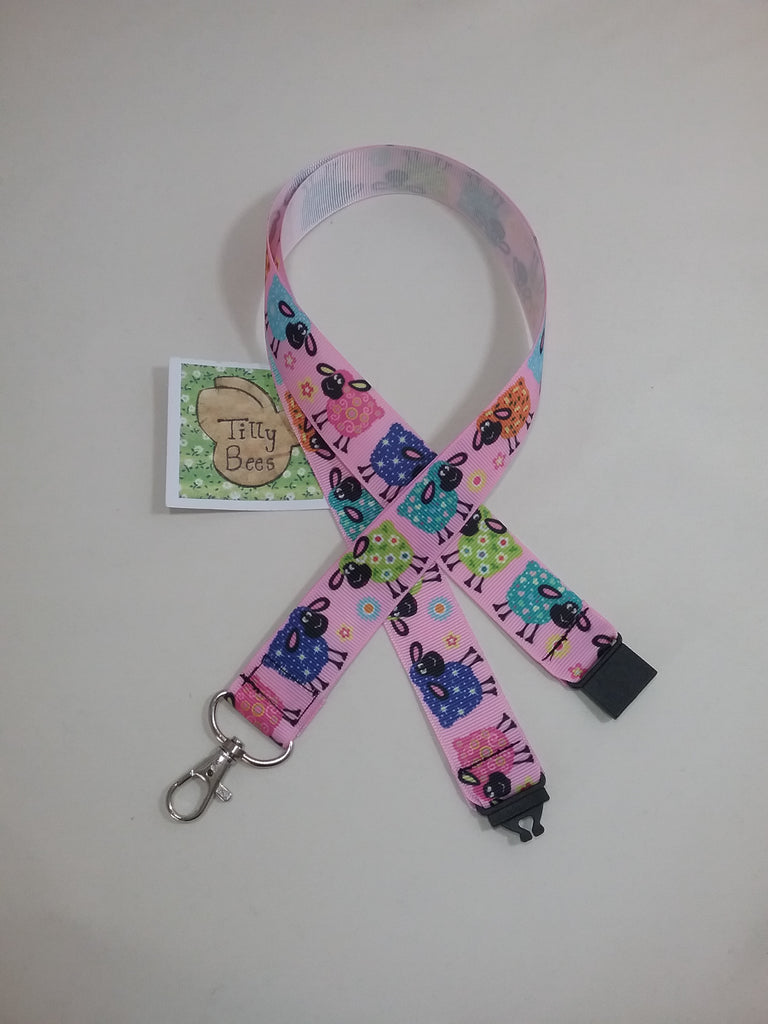 Coloured cartoon sheep on pink ribbon lanyard made with a safety quick release breakaway id or whistle holder with swivel lobster clasp - Tilly Bees