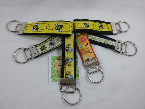 Choice of over 12 different Bee Pattern Fobs for use as keyring, zip pull, bag tags etc. Identity your bags easily or find your keys in your handbag.