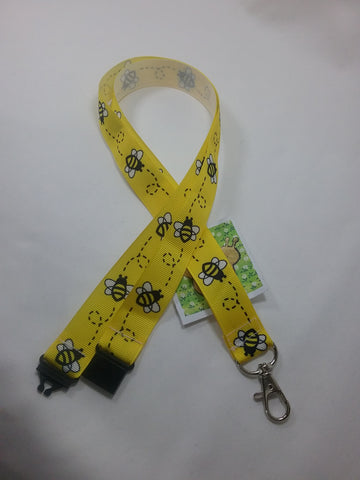 Bright Yellow Honey bee or Bumble Bee ribbon Lanyard it has a safety breakaway fastener with swivel lobster clasp lanyard id or whistle holder