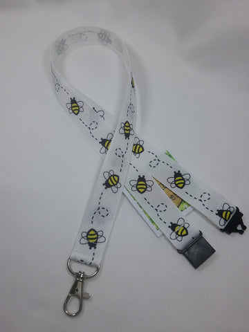 White Honey bee or Bumble Bee ribbon Lanyard it has a safety breakaway fastener with swivel lobster clasp lanyard id or whistle holder
