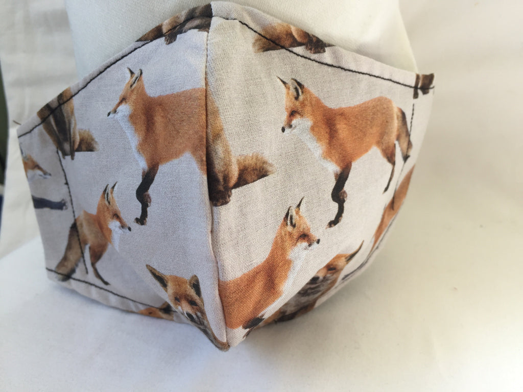 Handmade fitted face covering / mask with Foxes on a beige cotton fabric
