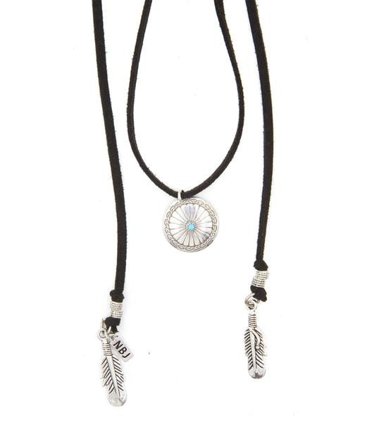 Vintage sterling silver charm with inlaid turquoise center stone on black vegan suede chord. Silver feather drops and accent beads. Pendant circa early 1970's.